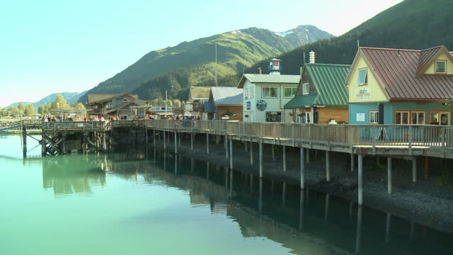 """""""colourful and picturesque buildings on boardwalk, green mountains in chugach national forest in background, sunny day seward, kenai peninsula, alaska."""" - kenai peninsula stock videos & royalty-free footage"""