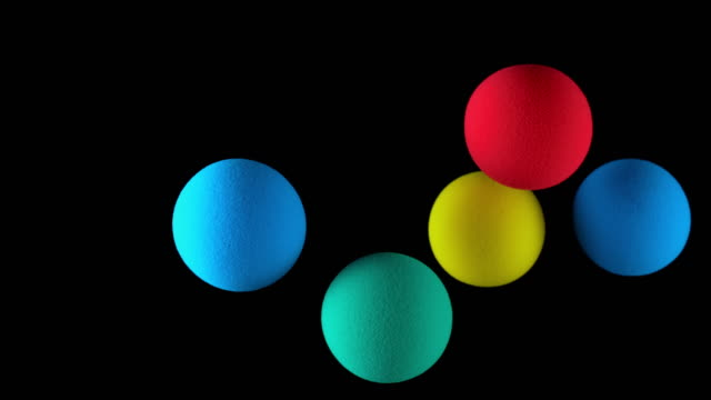 slo mo ld colourful balloons floating in the air against black background - five objects stock videos & royalty-free footage