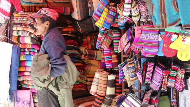 colourful bolivian fabrics for sale in la paz bolivia south america - mitten stock videos and b-roll footage