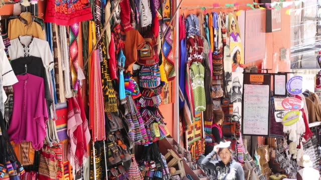 colourful bolivian fabrics for sale in la paz bolivia south america - neckwear stock videos and b-roll footage