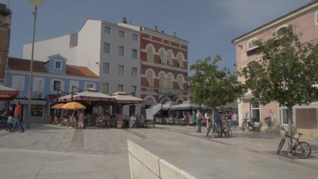 colourful buildings on trg slobode, porec, istra, adriatic sea, croatia, europe - square stock videos & royalty-free footage