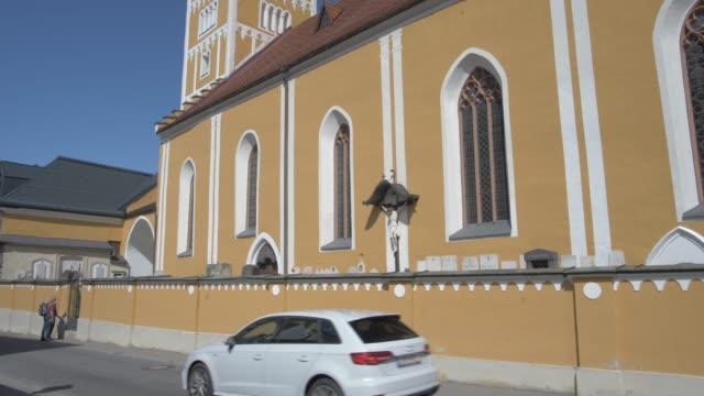 colourful catholic church on martin luther strasse, schladming, styria, austrian alps, austria, europe - austria stock videos & royalty-free footage