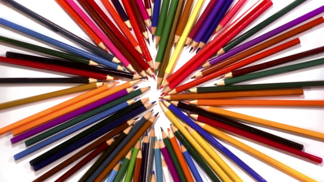 a colourful collection of pencils spin to reveal a white background. - david ewing stock videos & royalty-free footage