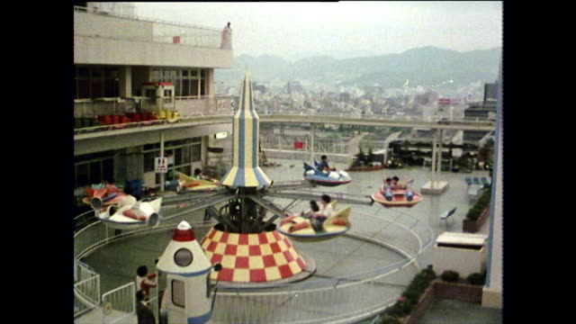 colourful fairground among concrete buildings in japan; 1975 - 1975 stock videos & royalty-free footage