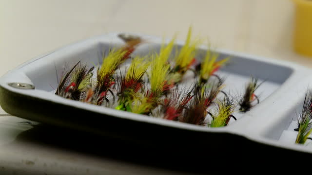 a colourful flies fishing handmade - group of objects stock videos & royalty-free footage