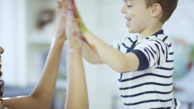 colourful hi-five - child care stock videos & royalty-free footage