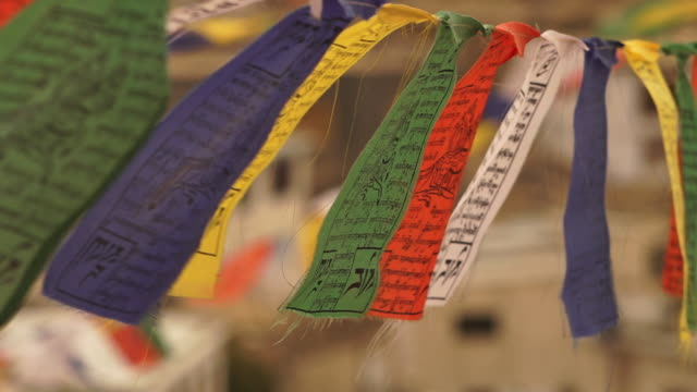 colourful high hanging prayer flags in  leh town - praying stock videos & royalty-free footage