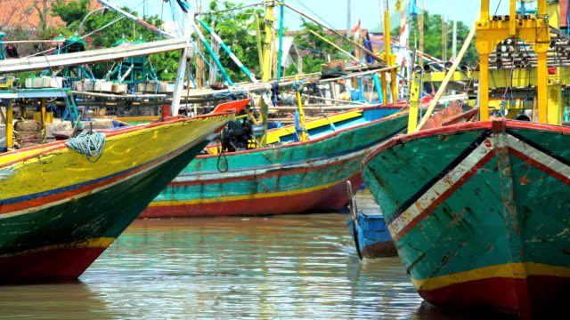 colourful indonesian local traditional fishing boats java indonesia - probolinggo stock videos & royalty-free footage