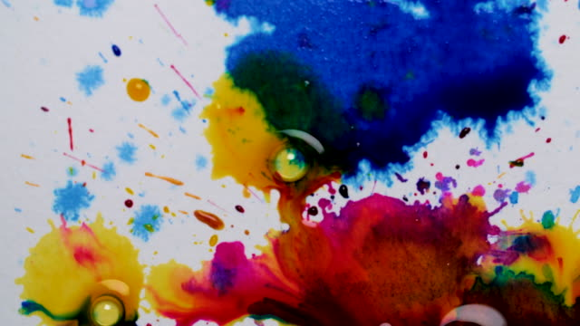 colourful ink droplets on white background - liquid stock videos & royalty-free footage
