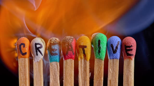"""slo mo ld colourful matches with inscription """"creative"""" being lit on fire - medium group of objects stock videos & royalty-free footage"""