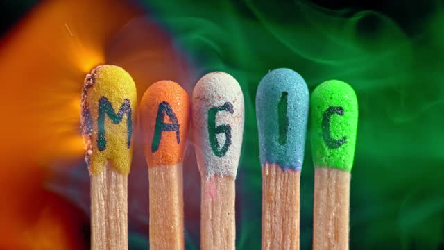 """stockvideo's en b-roll-footage met slo mo ld colourful matches with inscription """"magic"""" being lit on fire - vijf dingen"""