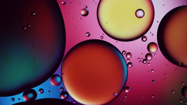 colourful patterns of oil drops in water - essential oil stock videos & royalty-free footage