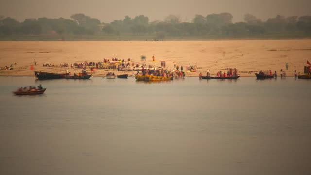 colourful pilgrims on the water's edge at kumbh mela festival - drying stock videos and b-roll footage