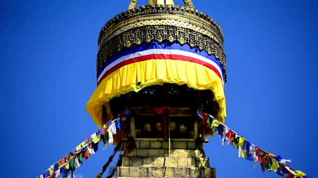 colourful prayer flags and golden bhuddist stupa temple kathmandu nepal - kathmandu stock videos & royalty-free footage