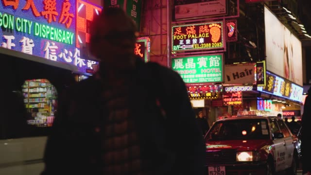 Colourful shops and neon signs of Kowloon, Hongkong, China