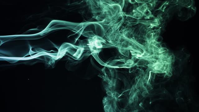 stockvideo's en b-roll-footage met kleurrijke rook op zwarte achtergrond - zichtbare adem