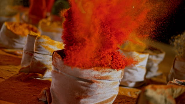 slo mo ld colourful spices exploding out of the bags and into the air - spice stock videos & royalty-free footage