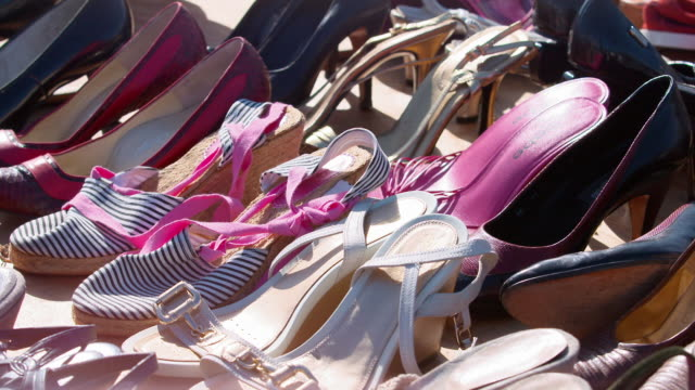 cu td colourful varieties of sandals in outdoor market for sale / los angeles, california, united states - pair stock videos & royalty-free footage