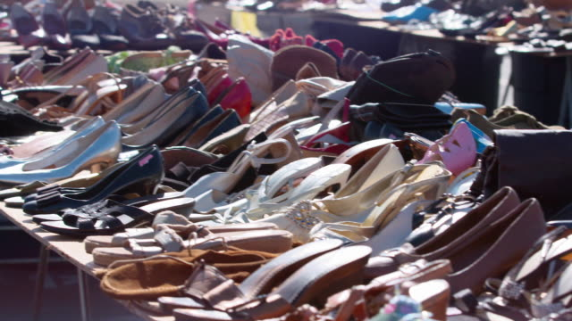 ms pan colourful varieties of sandals in outdoor market for sale / los angeles, california, united states - pair stock videos & royalty-free footage