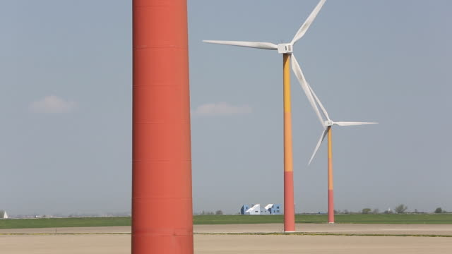 colourful wind turbines operated by nuon, near almere in flevoland, netherlands. they are sited on reclaimed polder land that is below sea level. - polder stock videos and b-roll footage