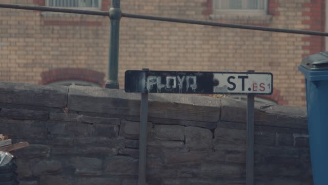 """colston street"" sign in bristol, which has been spray-painted over with the name ""floyd"", in remembrance of george floyd, in bristol, united kingdom. - street name sign stock videos & royalty-free footage"