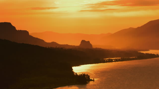 AERIAL Columbia River at sunrise with Beacon Rock in the distance