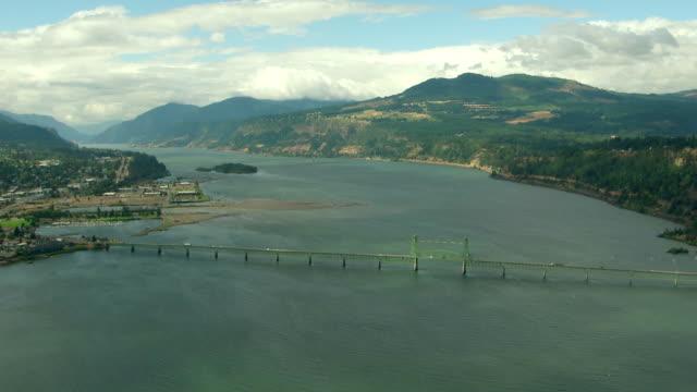 ws aerial columbia river gorge and suspension bridge spanning columbia river / oregon, united states - columbia river gorge stock videos & royalty-free footage