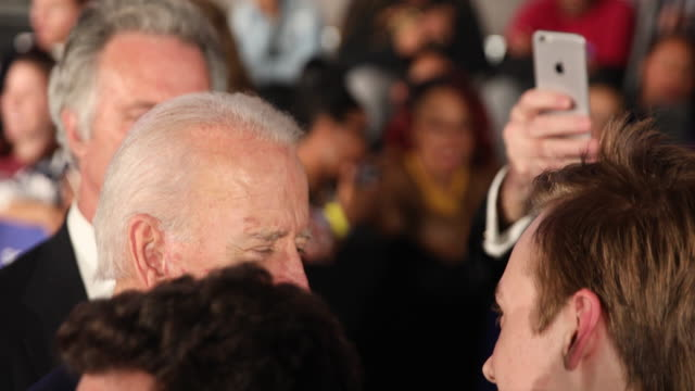 vídeos de stock, filmes e b-roll de democratic nomination hopeful joe biden poses for photos with and speaks personally to supporters after giving a victory speech on primary night at... - primary election
