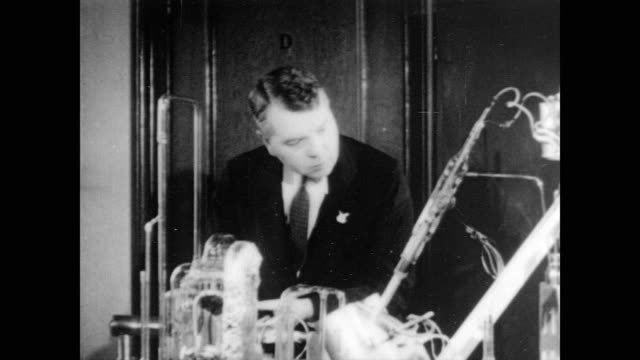 columbia university / nobel prize winning chemist harold clayton urey standing behind an experiment compromised of many tubes attached to each other... - 1935 stock videos and b-roll footage