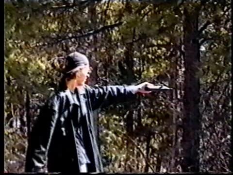 Columbine killer Dylan Klebold practice shooting gun in woods for video made six weeks before school massacre/ Littleton Colorado USA/ AUDIO