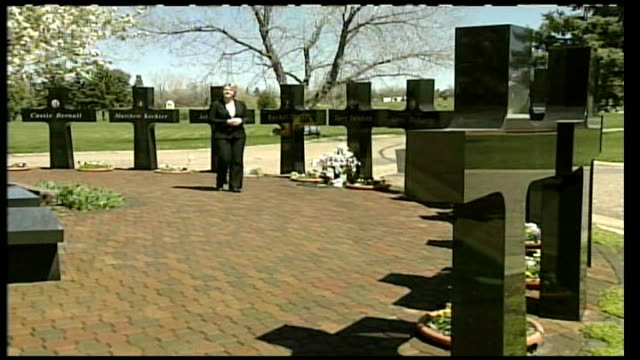 columbine school massacre anniversary ext reporter to camera at memorial to columbine massacre - murder stock videos & royalty-free footage