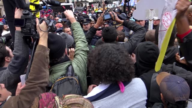 columbus circle – central park, police scuffle erupted with anti-trump protestors during rally when protestors allegedly started throwing water... - protestor stock videos & royalty-free footage