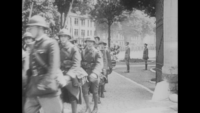 ms column of french soldiers march down street toward camera turn and exit screen left / ms french soldiers march toward and past camera at screen... - esercito militare francese video stock e b–roll
