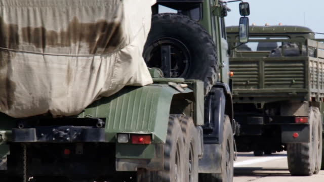 column of military equipment - army exercise stock videos and b-roll footage