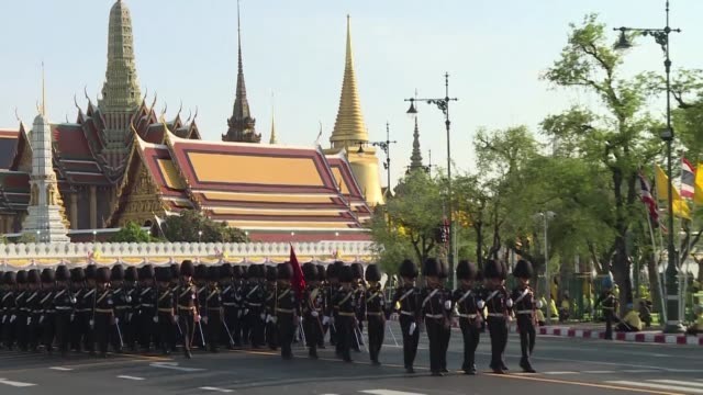 a column of military men carrying a gilded palanquin sweep through bangkok's old quarter in a dress rehearsal for the royal procession of thai king... - gilded stock videos & royalty-free footage