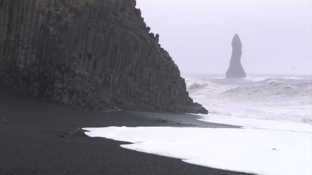 columnar basalt cliff pounded by surf. - dyrholaey stock videos & royalty-free footage