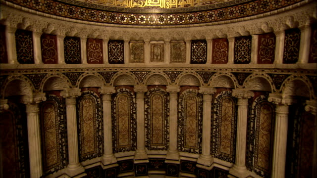 Columns and mosaic decorate a recess in a mosque wall in the Umayyad Mosque Damascus. Available in HD.