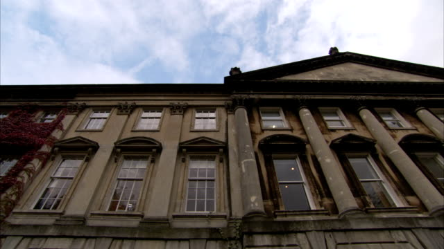 Columns and windows cover the face of a townhouse, Bath. Available in HD.