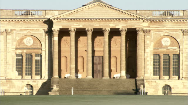 Columns cast shadows on the portico of Stowe House in Buckinghamshire, England. Available in HD.