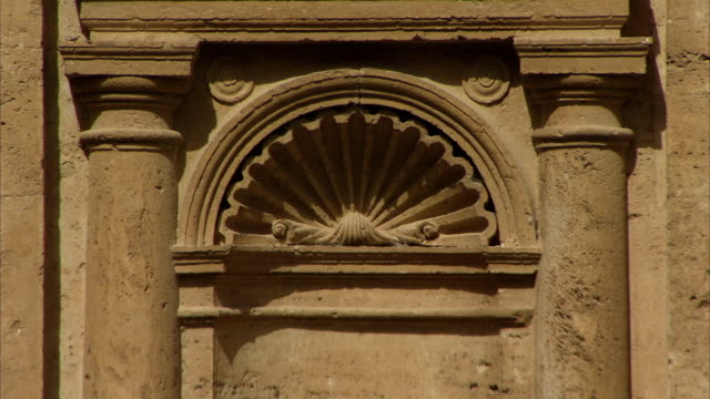 columns flank either side of a carved shell on the exterior of san biagio of montepulciano. available in hd. - montepulciano stock videos & royalty-free footage