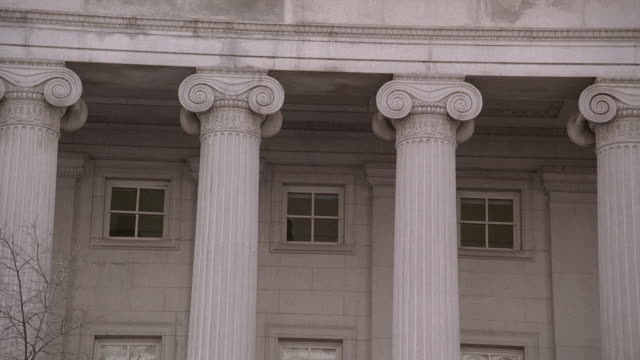 la columns, ionic capitals, and windows of the u.s. treasury department building / washington, d.c., united states - finanzministerium stock-videos und b-roll-filmmaterial
