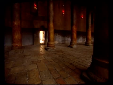 columns line the interior of the church of the nativity in bethlehem. - church of the nativity stock videos and b-roll footage