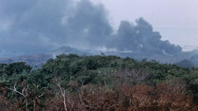 columns of black and white smoke rising from battlefield / saipan mariana islands - saipan stock videos and b-roll footage