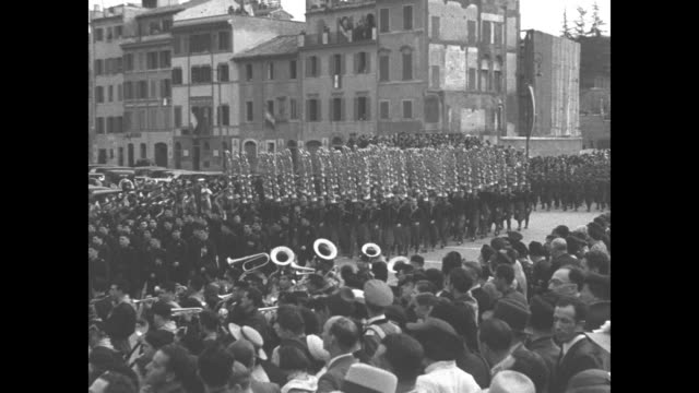 vs columns of italian fascist troops in the piazza venezia in rome / columns of troops of different branches of the military march by italian prime... - piazza venezia stock videos and b-roll footage