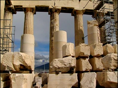 columns of parthenon framing athens and greek flag in distance athens - doric stock videos & royalty-free footage