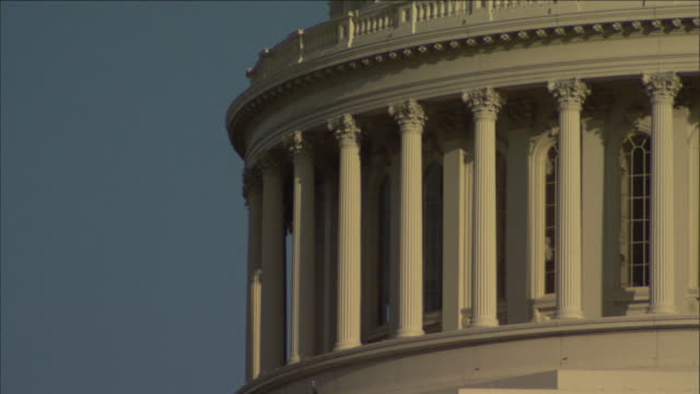 columns surround a rotunda below the dome of the united states capitol in washington, d.c. - rotunda stock videos & royalty-free footage