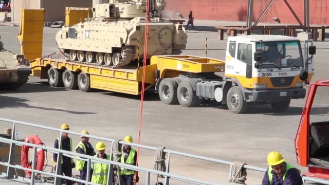 combat armed vehicles being loaded aboard the us army's sp/4 james a loux or lsv6 at the port of shuaiba kuwait the equipment was transported to the... - union army stock videos and b-roll footage