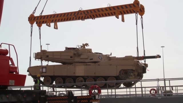 combat armed vehicles being loaded aboard the us army's sp/4 james a loux or lsv6 at the port of shuaiba kuwait the equipment was transported to the... - military exercise stock videos and b-roll footage