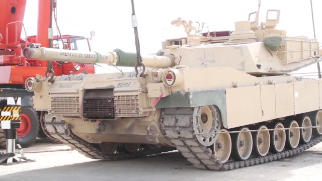 combat armed vehicles being loaded aboard the us army's sp/4 james a loux or lsv6 at the port of shuaiba kuwait the equipment was transported to the... - weaponry stock videos & royalty-free footage