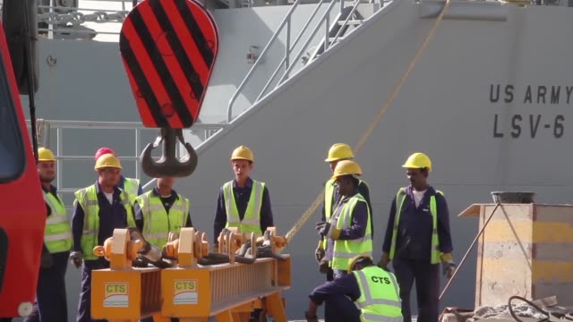 combat armed vehicles being loaded aboard the us army's sp/4 james a loux or lsv6 at the port of shuaiba kuwait the equipment was transported to the... - union army stock videos & royalty-free footage